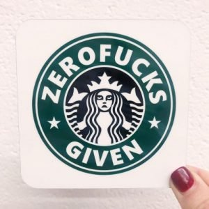 A bucks parody coaster with a comedy version of the Starbucks logo which has Zerofucks Given printed on it.