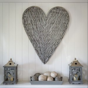 A stunning 87 cm Wicker Wall hung heart from Retreat Home. Fills a wall above a fire place or bed.