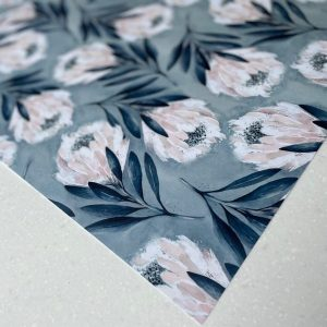 A sheet of floral wrapping paper which has lovely blue and pink tones.