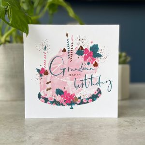 A square floral card from Hotchpotch's Raspberry range. With an image of a cake with the wording Grandma Happy Birthday printed on it.