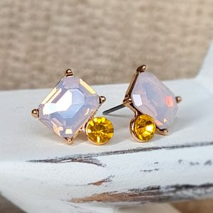 Vintage style stud earrings featuring a large baguette cut crystal in rose water opal above a small rose cut citrus crystal all set in antique gold