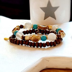 A tribal beaded bracelet with a double strand of beads in brown turquoise and gold