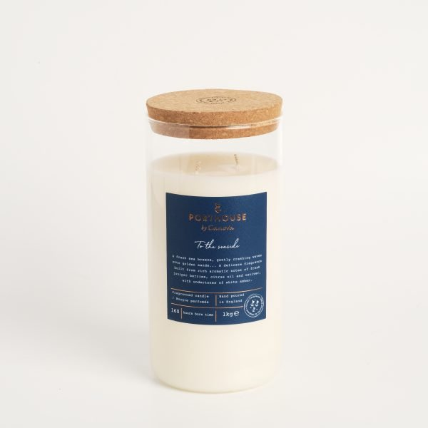 A large glass jar candle which has a cork lid. From the Porthouse range of candles by Cavona. The To The Seaside candle has aromas of berries, citus and amber .