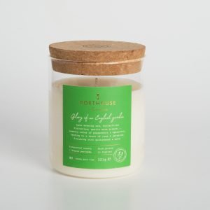 A class jar candles which has a cork lid. From the Porthouse range of candles by Cavona. The Glory of an English Garden has aromas of flowers and mosss and wood..