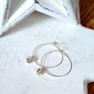 Silver hoops with a clear crystal set in silver