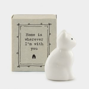 A sweet little ceramic cat in a little matchbox and the words Home is wherever I'm with you printed on it.