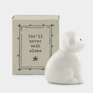 A sweet little ceramic dog keepsake in a little matchbox with the words You'll never walk alone' printed on it
