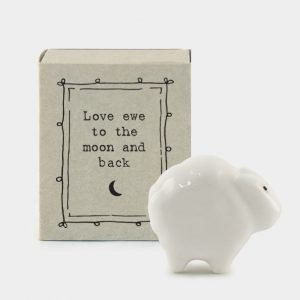 A cute little sheep ceramic keepsake in a matchbox with the words Love you to the moon and back printed on it
