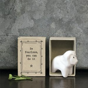 A sweet little lion ceramic keepsake in a matchbox with the words Be Fearless you can do it printed on it.