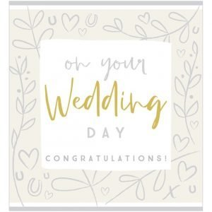 A silver and gold wedding card. With a silver border with a delicate leaf and heart pattern and a central white panel with the works on your wedding day congratulations. Wedding is in gold foil