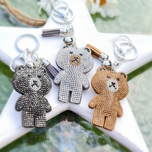 A crystal encrusted bear key ring in a choice of gold silver or black crystals