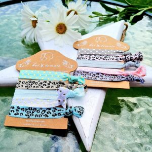 Five colurful patterned bands that you can wear on your wrist or in your hair