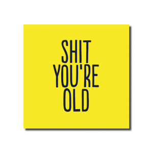 A yellow square card emblazoned with SHIT YOU'RE OLD