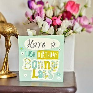 A geordie card in beautifully illustrated text that reads have a lush birthday bonny lass