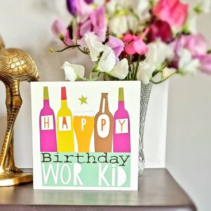 A geordie birthday card for wor kid illustrated with bottles and Happy Birthday Wor Kid