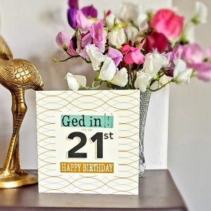A geordie 21st birthday card with a geometric design in cream and mustard with teal and black. Ged in#!! 21st Birthday