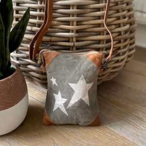 A star cross body bag with adjustable strap. Made from recycled leather and canvas, with 3 white stars printed on it.