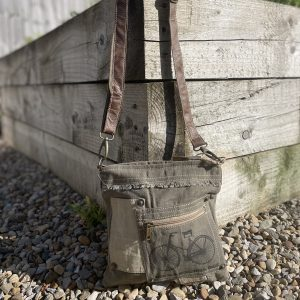 A cross body bag made from canvas and recycled leather with zip pocket on the front of it and an image of a bicycle printed on it.