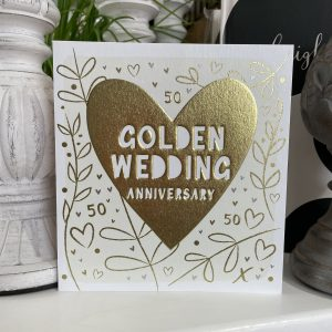A contemporary Golden Wedding Anniversary card with floral pattern, little hearts and 50's and a large golden heart in the centre of it.