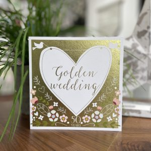 A lovely gold card with floral design and a large white heart with little white doves on it. The words Golden Wedding are printed in the centre of the heart
