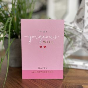 A lovely pink card with the words to my gorgeous wife printed oni t and with 2 little pink hearts on it.