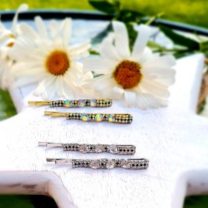 A pair of hair slides encrusted with clear crystal stones