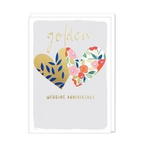 A golden wedding anniversary card with an illustration of 2 big hearts on a lilac background. The hearts have gold and flowered patterns and golden wedding anniversary is printed in gold foil