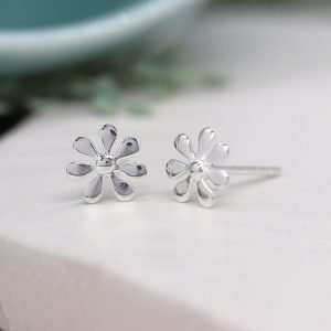 A sweet pair of sterling silver daisy stud earrings with a seven petal design