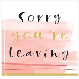 A large card with a pink watercolour wash background and the words Sorry you're leaving printed in black and gold shimmer print.