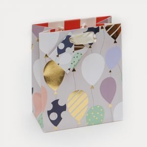 A medium sized gift bag with lots of colourful balloons