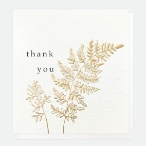 A thank you card with a gold foil leaf with thank you