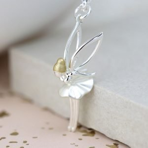 A sterling silver fairy necklace with a sweet little silver plated fairy pendant with golden hair, outline wings and a pretty tutu dress. Suspended from a fine silver plated chain