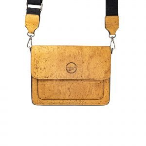 A tan coloured cross body bag which has a satchel look and internal zip pockets. The bag has a detachable brown strap. It is made from cork leather which has been produced from the whistler tree.