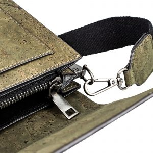 A khaki coloured cross body bag which has a satchel look and internal zip pockets. The bag has a detachable brown strap. It is made from cork leather which has been produced from the whistler tree.