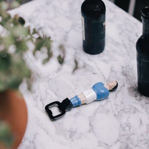 A cool and quirky bottle opener designed to look like a table football foosball player in a blue football strip.