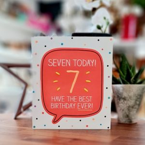 A bright spotty card with a big neon orange speach bubble with Seven today and a big 7 and have the best birthday ever!