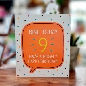 A spotty 9th birthday card with a big neon orange speach bubble with nne today have a hugely happy birthday written in the bubble