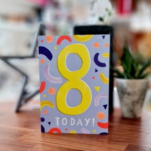 A bright 8th birthday card with a big yellow 8 and neon swirls