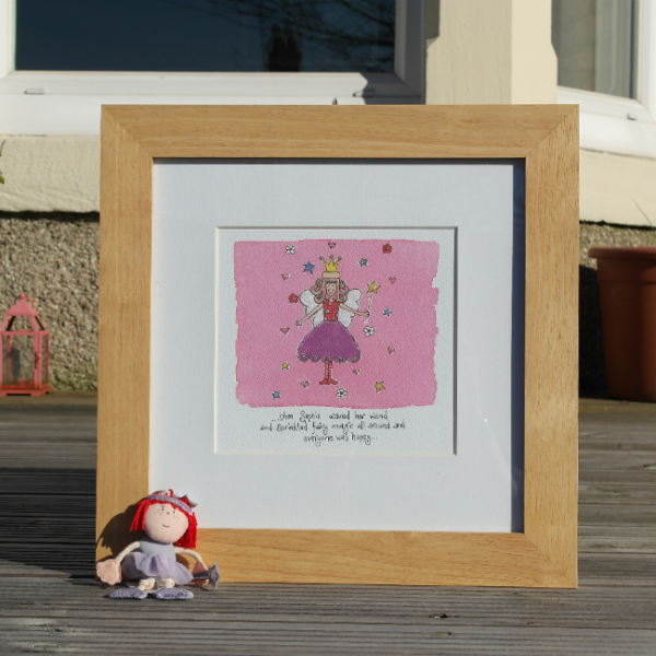 A personalised fairy print which is from an original watercolour painting which is personalised with a child's name and date of birth. The print is framed in an oak wooden frame.