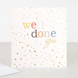A spotty well done card with well done printed in multi coloured letters