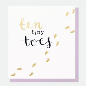 A new baby card. A white card with little foot prints and ten tiny toes written on the card
