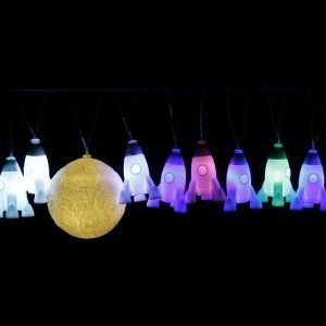 A set of string lights with litte rockets and moons on them.