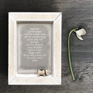 A little wooden picture with a little wooden dog and the words Hold her a little longer, rock her a little more, tell her another story you've only read her 4. Let her sleep on your shoulder, rejoice in her happy smile, she is only a little girl for such a little while