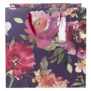 A large 38cm square floral gift bag in deep purple, burgundy and pink flowers