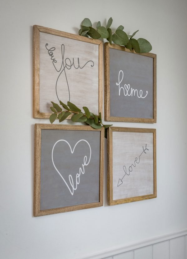 Grey and white pictures depicting love in a wooden frame. A choice of 4