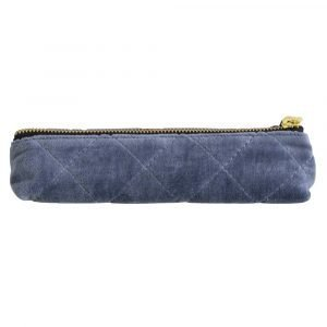 A blue velvet quilted pouch for keeping either pens and pencils or cosmetic brushes in.