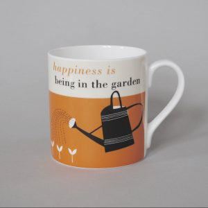 A wonderful bone china mug with an orange design on it wiht a watering can and the wording Happiness is being in the garden printed on it.