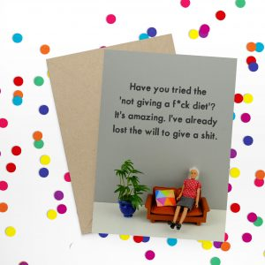 """A hilarious card with a photo of a Barbie doll on a sofa. Have you tried the """"not giving a f*ck diet?"""""""