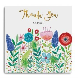 A card with lots of brightly coloured flowers and Thank You So Much in gold foil letters