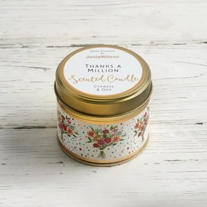 Thanks a million candle. A cypress and oak scented candle in a tin